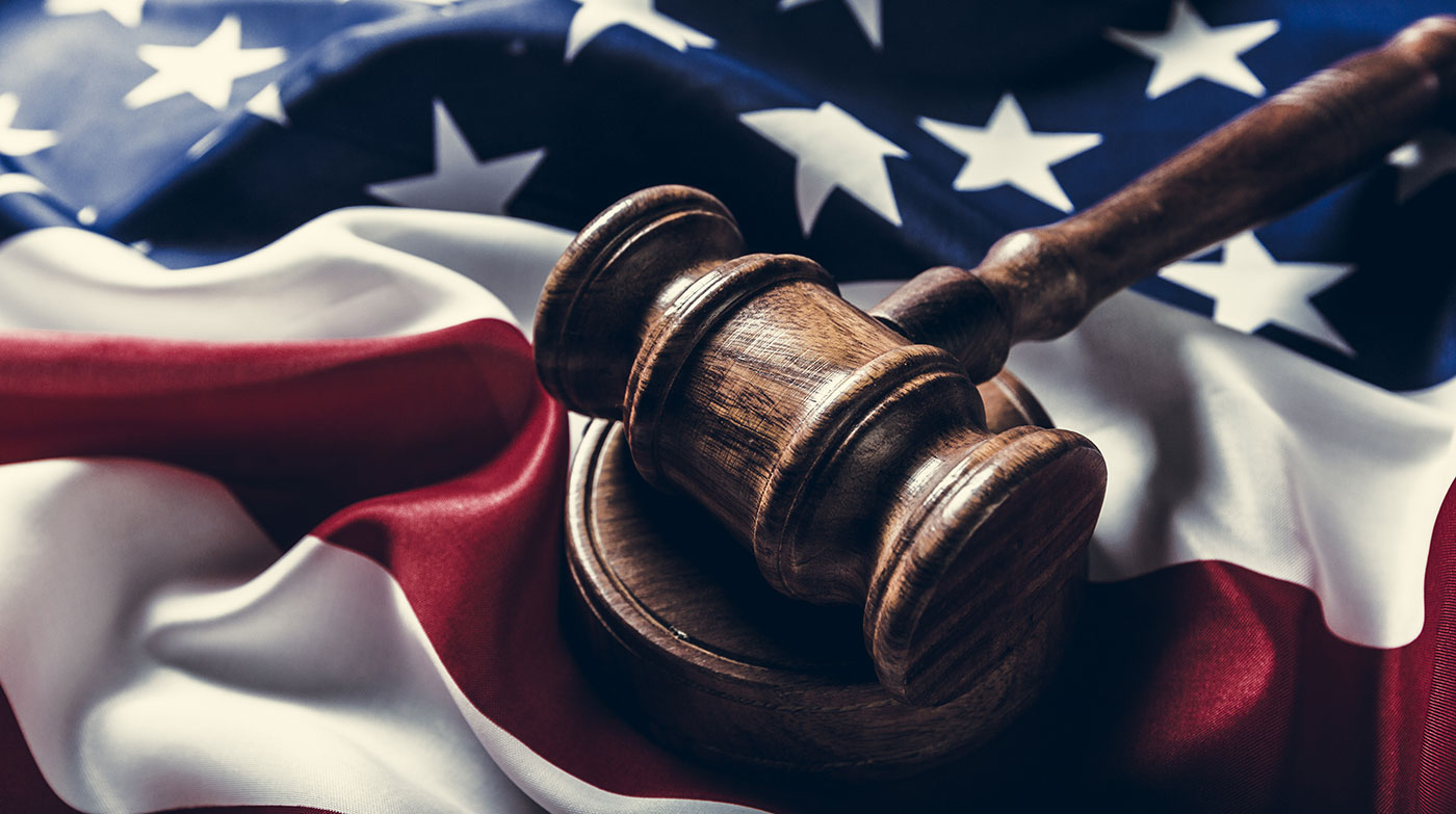 A gavel set on-top of an American Flag, representing the justice system and Criminal Defense Lawyers in Peoria IL