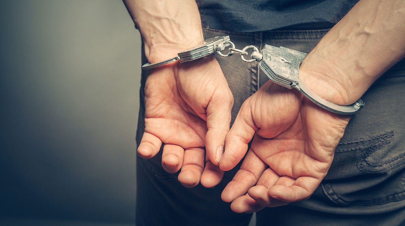 A man in handcuffs facing Misdemeanor Charges in Peoria IL