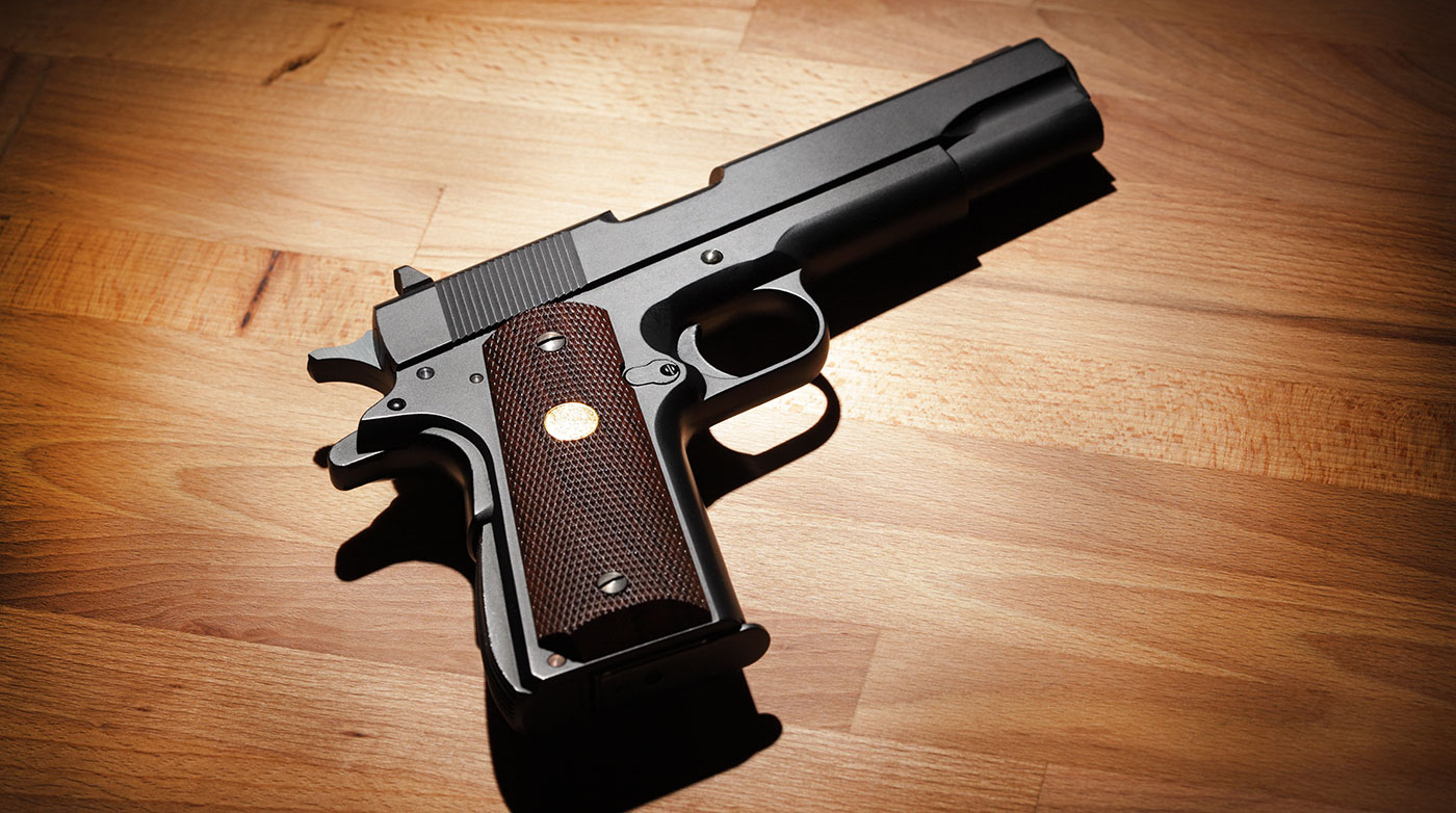 A pistol, the center of a case for Weapon Charges Lawyers in Peoria IL