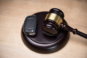 A set of car keys on a gavel, representing a DUI Lawyer in East Peoria IL